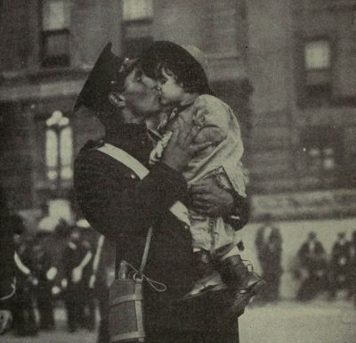 A Canadian soldier kisses his daughter goodbye