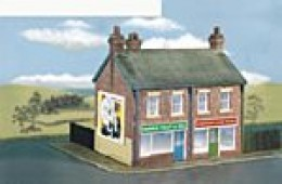 More advanced are Wills' Craftsman kits semi-detached shops and flats. There's a lot of work  and a strong hand is needed for scoring cuts on the backs of the plastic sheets with opposite corners mitred  A range of Wills' kit variations is available
