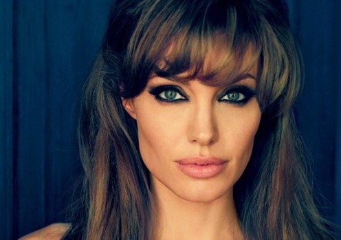 Angelina Jolie with her blue eyes in smokey eye makeup