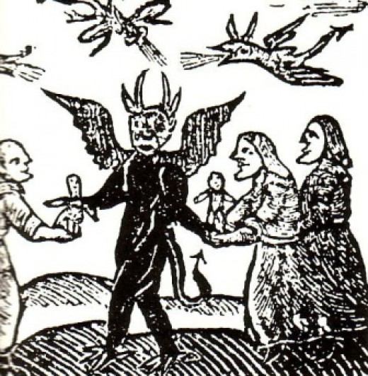 Illustration circa 1561 of witches bringing children to the Devil