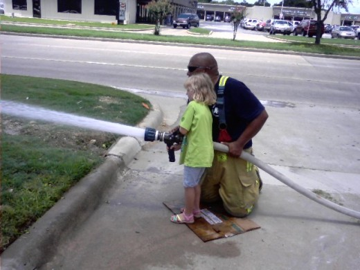 my oldest granddaughter at a local fire department event