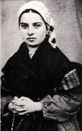 Who was Bernadette Soubirous and what exactly were her visions about?