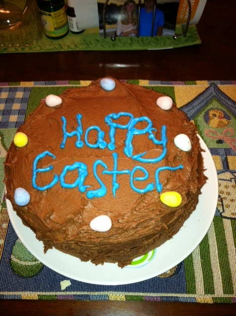 A yellow cake made for Easter decorated with mini Cadbury eggs.