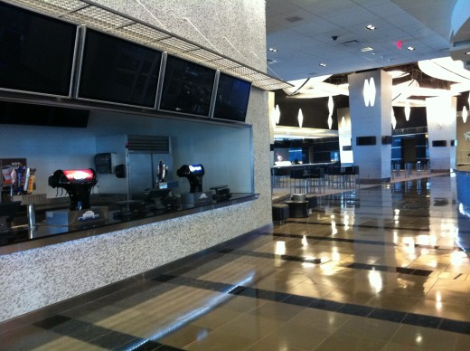 Concession stand with TVs above for lower level seating.