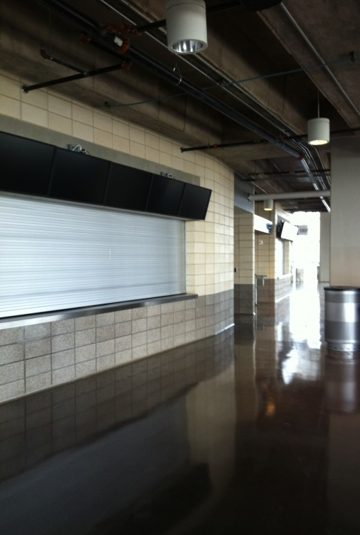 Concession stand with TVs above for upper level seating.