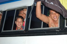Happy Venezuelan boys on bus