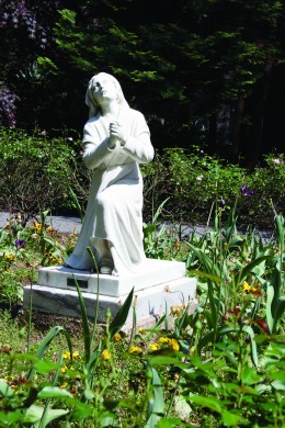 Statue of St. Bernadette near Grotto of Lourdes.