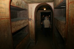 The reproduction of catacombs includes niches for the dead.