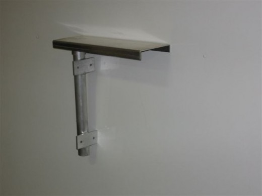 Swing arm to make any mail box snow plow resistant.