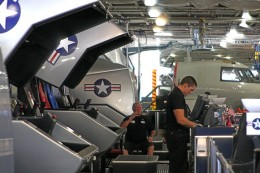Guest operate their own flight simulator ride on board the USS Midway Museum