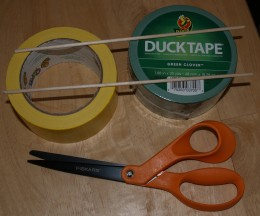 Duck® Tape, wooden dowels, and scissors with non-stick blades.