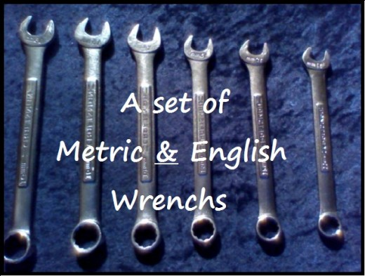"Metric & English wrenchs are mandatory if you intend on fixing anything on your car. If you can only get a few I'd recommend: 5/16"", 1/2"", 9/16"" and 8mm, 10mm and 14mm."