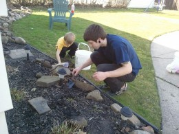 Nephew Billy and great nephew Owen digging for worms.  Maybe Owen will own a Bait & Tackle Shop one day?