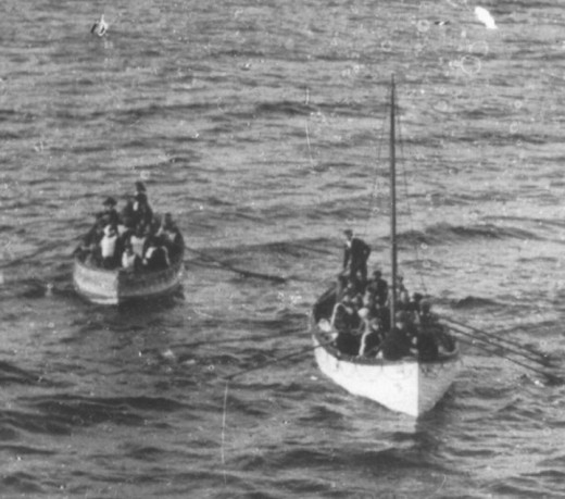 Standard  lifeboat No. 14 towing an Englehardt collapsible life toward R.M.S Carpathia