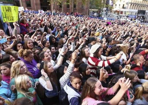 One Direction female fans outside the Channel 7 studio in Sydney, Australia. Security had to be called to control the hundreds of girls who had come to see the boy band.