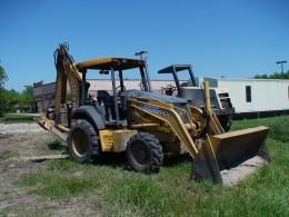 Combination bulldozer and back hoe.