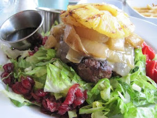 The Counter: 1/3 lb Burger in Lettuce Bowl with Grilled Onions, Pineapple, Red Peppers, Drice Cranberries, and Teriyaki Sauce