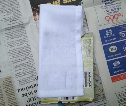 Step 2:  Place a piece of paperboard under first layer of napkin