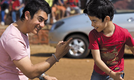 Aamir Khan with Darsheel Safary in Tare Zameen Par. A good movie to watch.