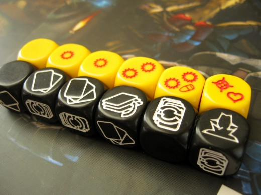 The two sets of custom dice. Yellow is used for mostly everything, while black is only for searching, spying and torturing.