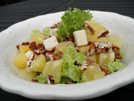 Quick and easy pineapple salad meal, good for raw diet, raw food detox, vegans, vegetarians and healthy food lovers; made with pineapple, pecans, salad greens and optional cheese.