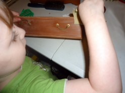 my little boy helping with sanding one of the drawers