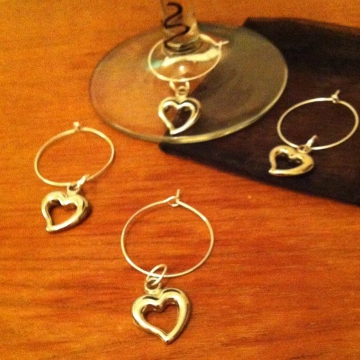 You can purchase charms and add them to wine glass rings.