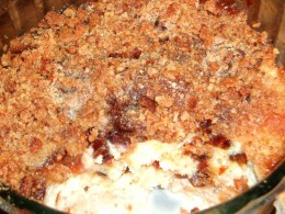 bread and butter pudding with a crunchy top of jam and breadcrumbs