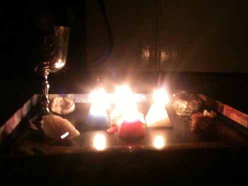 A simple make-shift altar set up in five minutes just with what was at hand. We used it as a canter piece while we meditated.