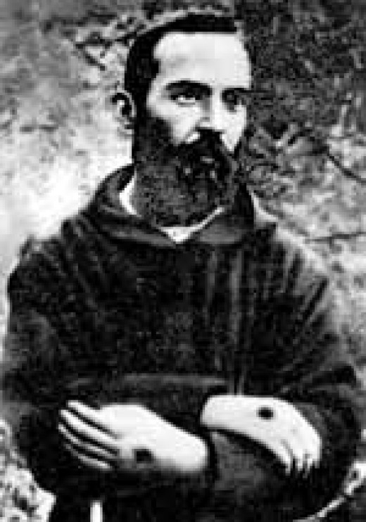 Here is a picture that is said to be authentic that portrays Padre Pio with pierced hands.
