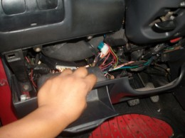 opening the cover under the dashboard