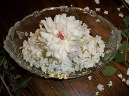 Fill the outer bowl with snowball bush petals, or some other tiny petals, and replace peony in the small jar.