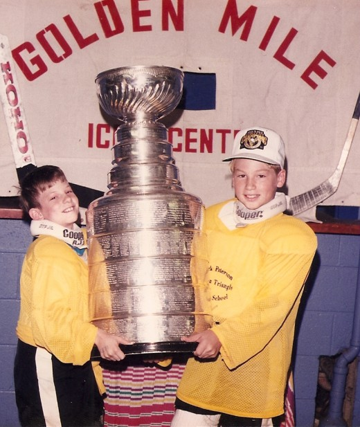 Brian (left) and his older brother Jeff hoist the Stanley Cup