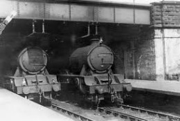 A pair of locos awaits the 'off'' , the one on the left has an express passenger  - on the right is a stopping train - how do we know this? See below