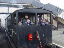 Midland van at Llangollen takes passengers on brakevan rides - different companies had different usage until 'Grouping' in 1923