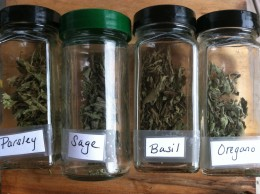 Store dried herbs in an air-tight container, such as a recycled glass spice jar