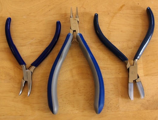 Jewelry-making pliers: bent nose pliers are on the left, round nose pliers are in the middle, and nylon jaw pliers are on the right.