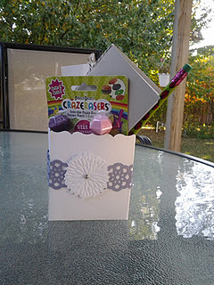 favor bag stuffed full of make and take craft items, mini drawing book and more