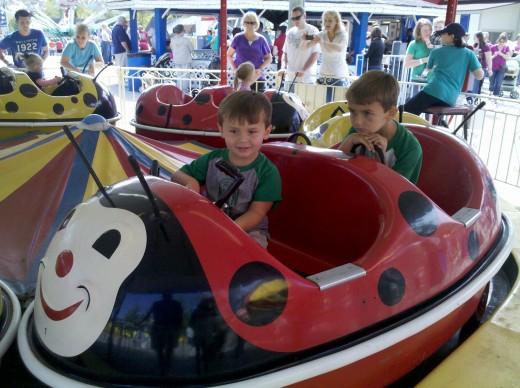 My boys having fun on the Lady Bugs.