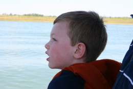 My six year old son looks on in awe as we zoom out of Murrell's Inlet.