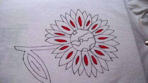 Begin coloring.  I started with the small petals - I chose a small space to get a feel for how the markers would react on the fabric.