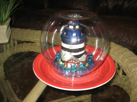 I used a lighthouse and glass gemstones in the base of the totem.