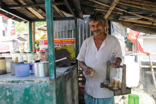 A vendor in India offering freshly prepared chai.