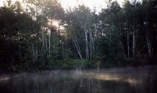Cool late August mornings create mist from warm Moccasin Lake