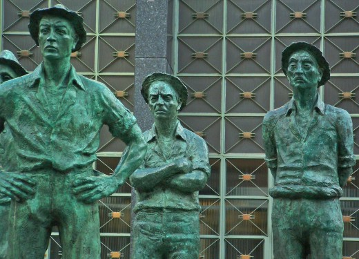 Bronze statues outside the National Bank.