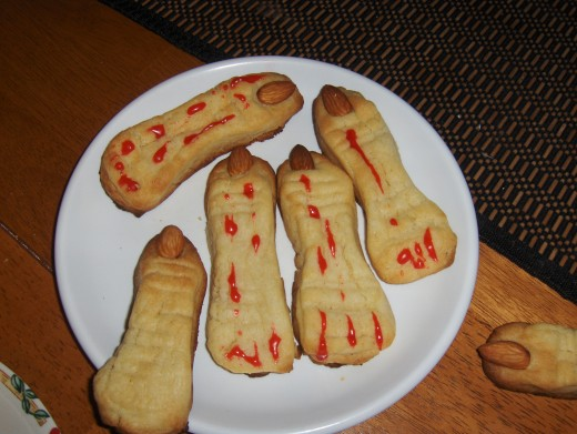 2.  Monster Fingers with Almond Fingernails for Halloween touches-I loved making the knuckle wrinkles with the knife...and drizzling the red gel icing...