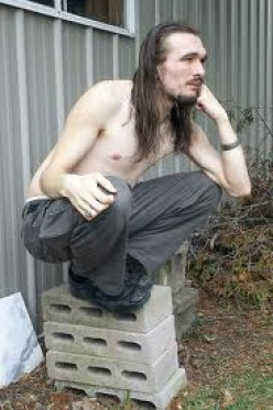 """THIS IS NOT WHAT """"I"""" DO DURING A POWER OUTAGE--SIT ON A CEMENT BLOCK. BUT IF IT WOULD HELP RESTORE THE POWER QUICKER, I'D BE RIGHT OUT THERE SQUATTING ON A CEMENT BLOCK."""