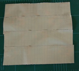 Four strips of Duck® Tape sticky side up, slightly overlapping each other.