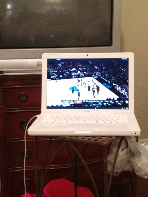 Watching NCAA Mens Basketball Tournament while using online application.