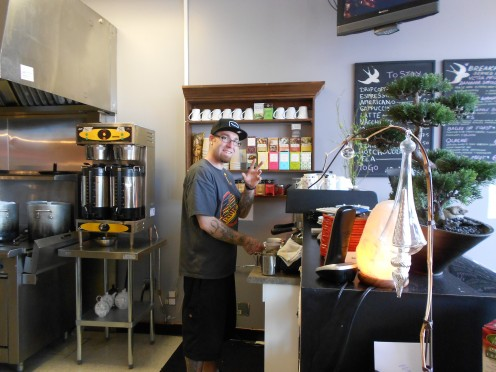 Jonathan, one of the super friendly staff, preparing a latte